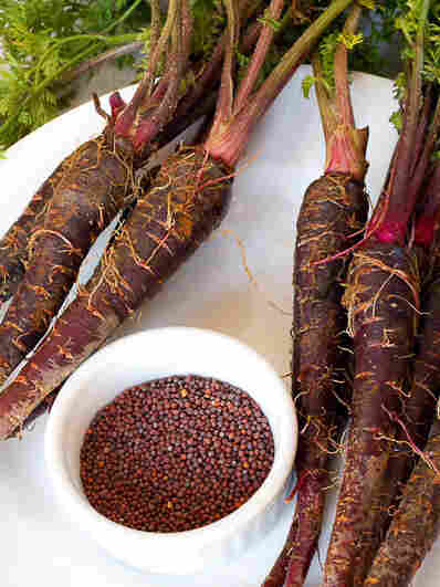 Black carrots and whole mustard seed, two main ingredients for making kanji.