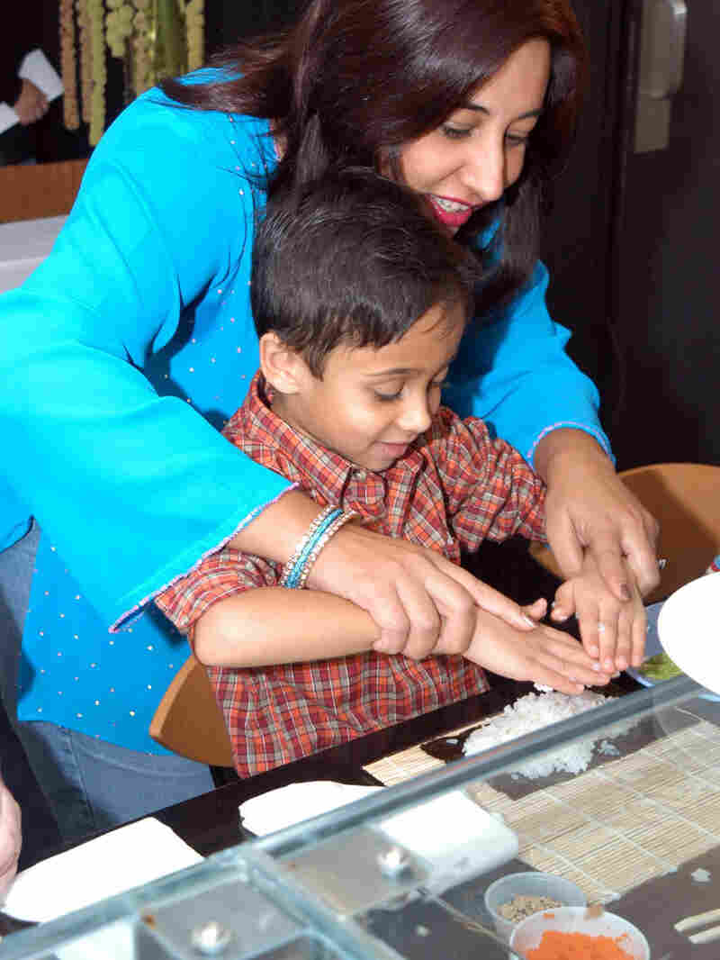 Monica Bhide and son making sushi