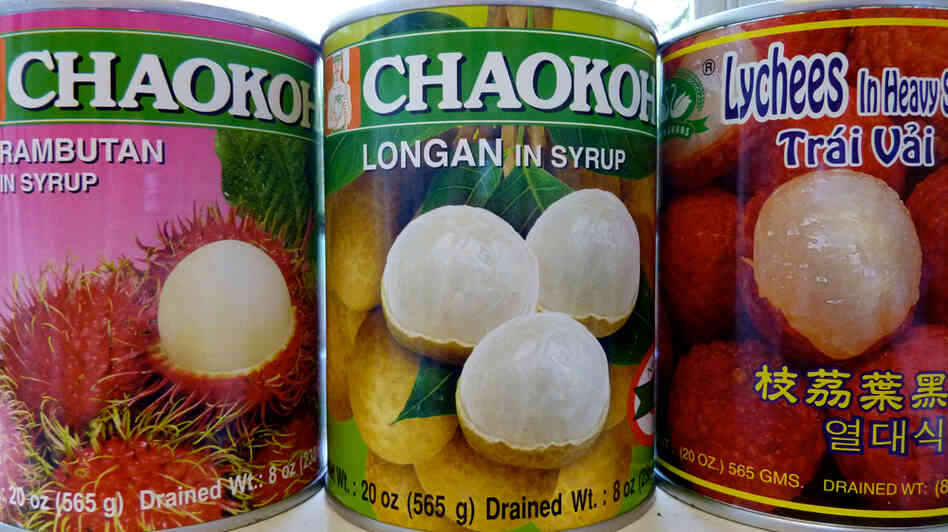 Cans of rambutan, longan and lychee fruits