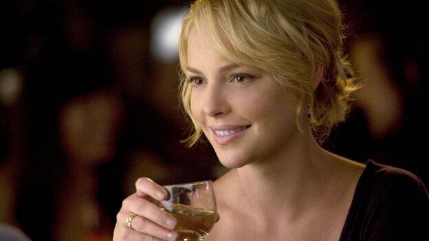 Katherine Heigl holds a glass of wine