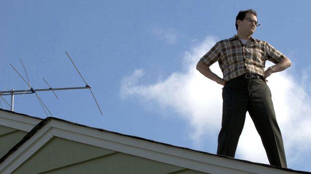 Larry Gopnik (Michael Stuhlbarg) stands on a roof