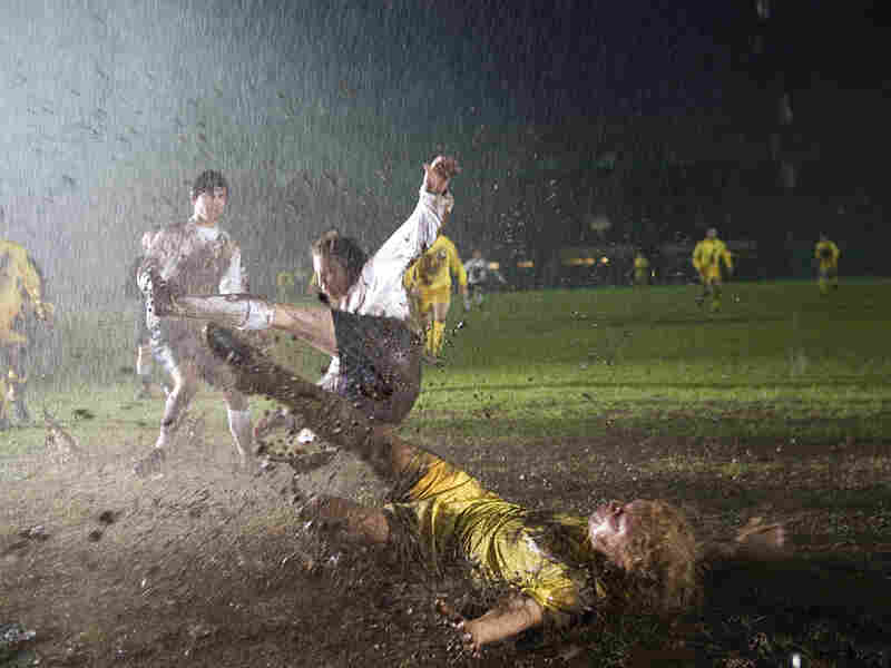 Billy Bremmer (Stephen Graham) performing a slide tackle in the mud