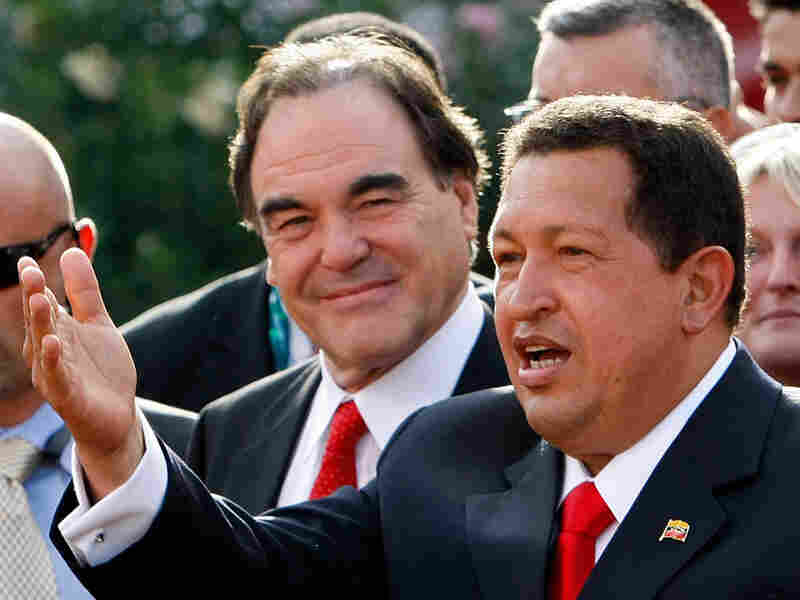 Director Oliver Stone (left) looks on as Venezuela's President Hugo Chavez acknowledges the crowd.