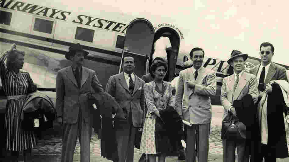 W:  Walt Disney and a group of artists disembark in Rio de Janeiro.