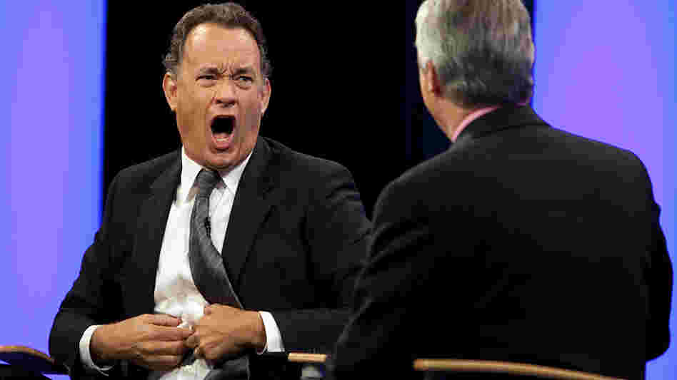 W: Tom Hanks makes a face at Scott Simon.
