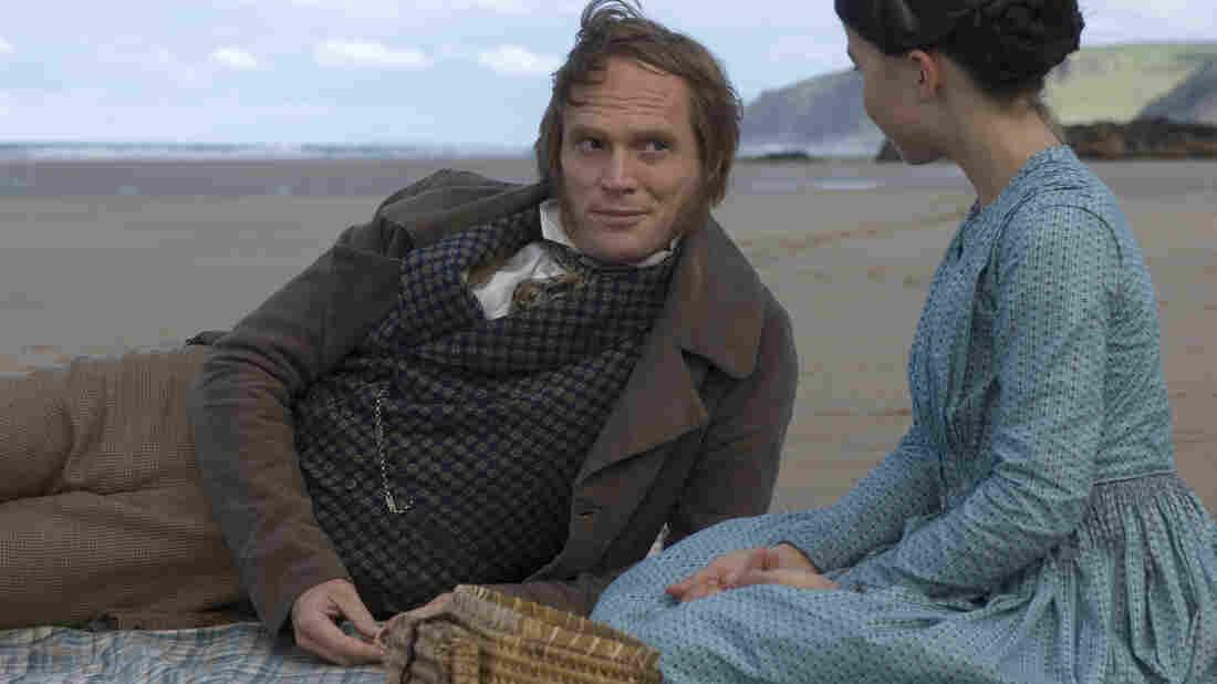 Paul Bettany and Martha West on a beach