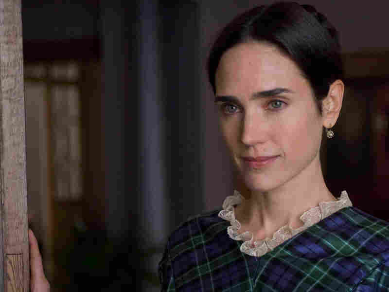 Jennifer Connelly in a plaid dress