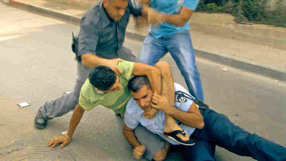 Men fight in the streets in a scene from 'Ajami.'