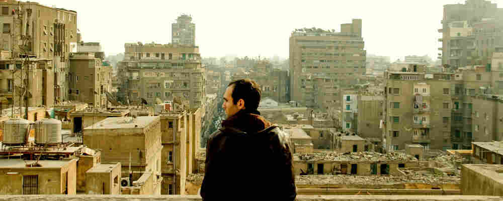 Khalid Abdalla looks out over Cairo.