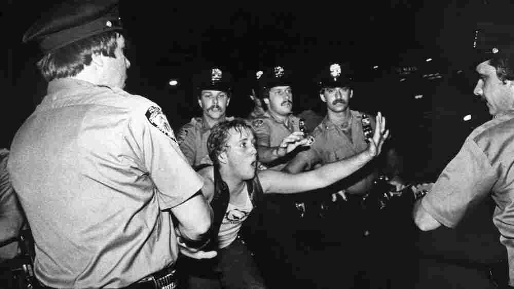 A patron of the Stonewall Inn confronts New York police