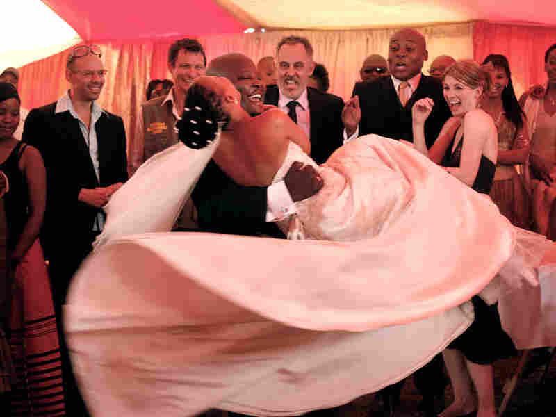 Elvis (Kenneth Nkosi) and Ayanda (Zandie Msutwana) dance in 'White Wedding'