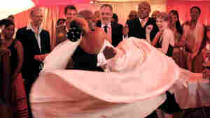 Elvis (Kenneth Nkosi) and Ayanda (Zandie Msutwana) dance in 'White Wedding'