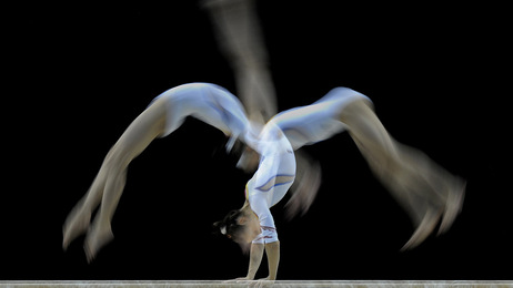 A competitor trains ahead of the Artistic Gymnastics World Championships 2009 at the 02 Arena, in east London, on October 12, 2009. Photo: CARL DE SOUZA/AFP/Getty Images)