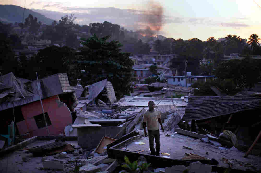 A man looks for his missing relatives in Haiti.