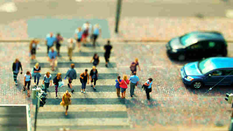 A miniature of people crossing the street.