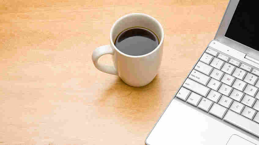Cofee cup and computer.