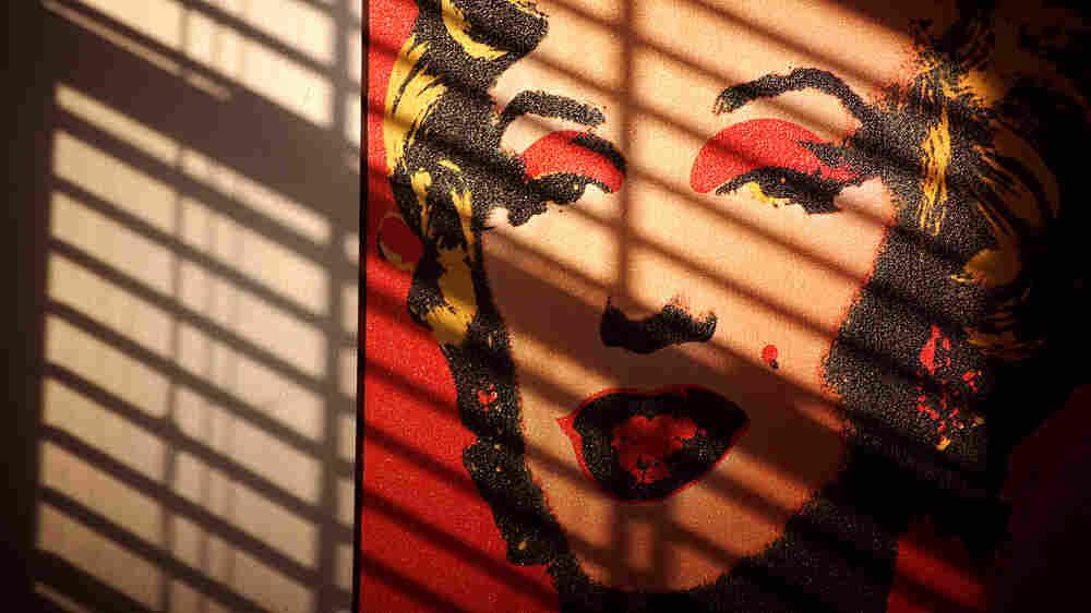 Marilyn Monroe through blinds.