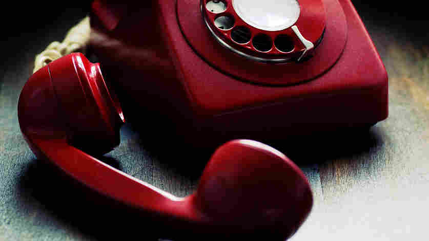 Red phone left of the hook.
