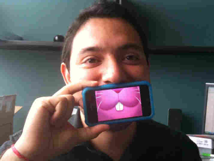Eyder Peralta holds an iPhone up to his face with the MouthOff app running. Credit: Wright Bryan, NP