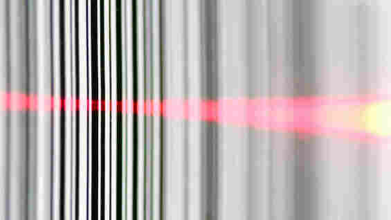 A barcode read by a laser.