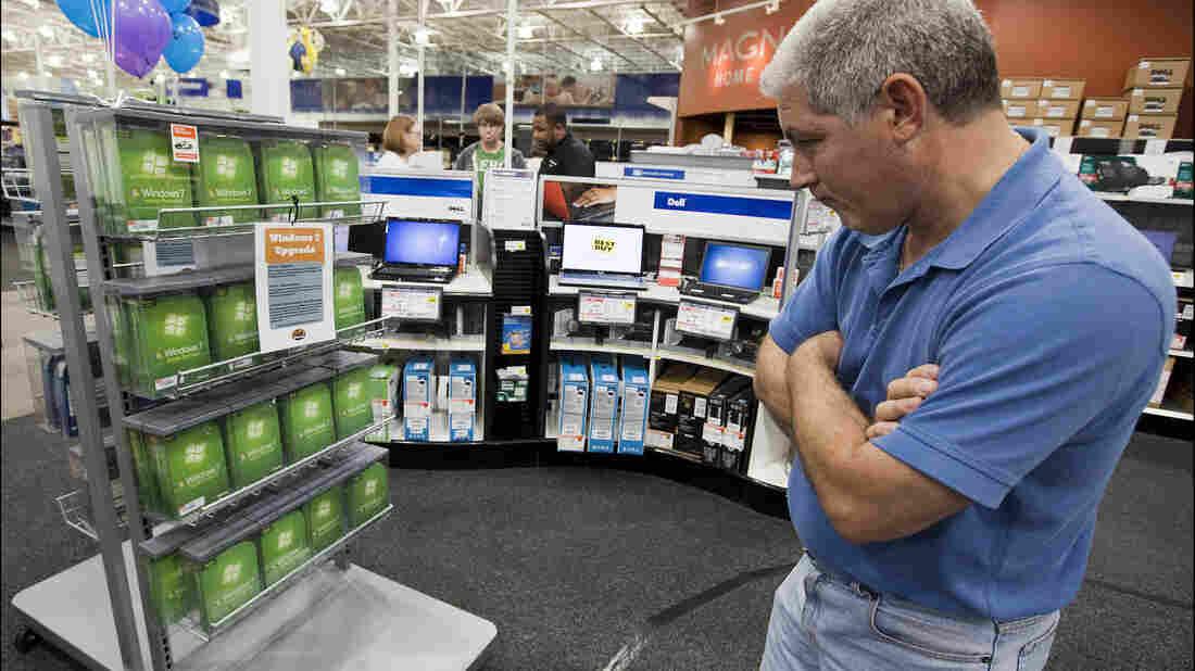 A man looks at a Windows 7 display.