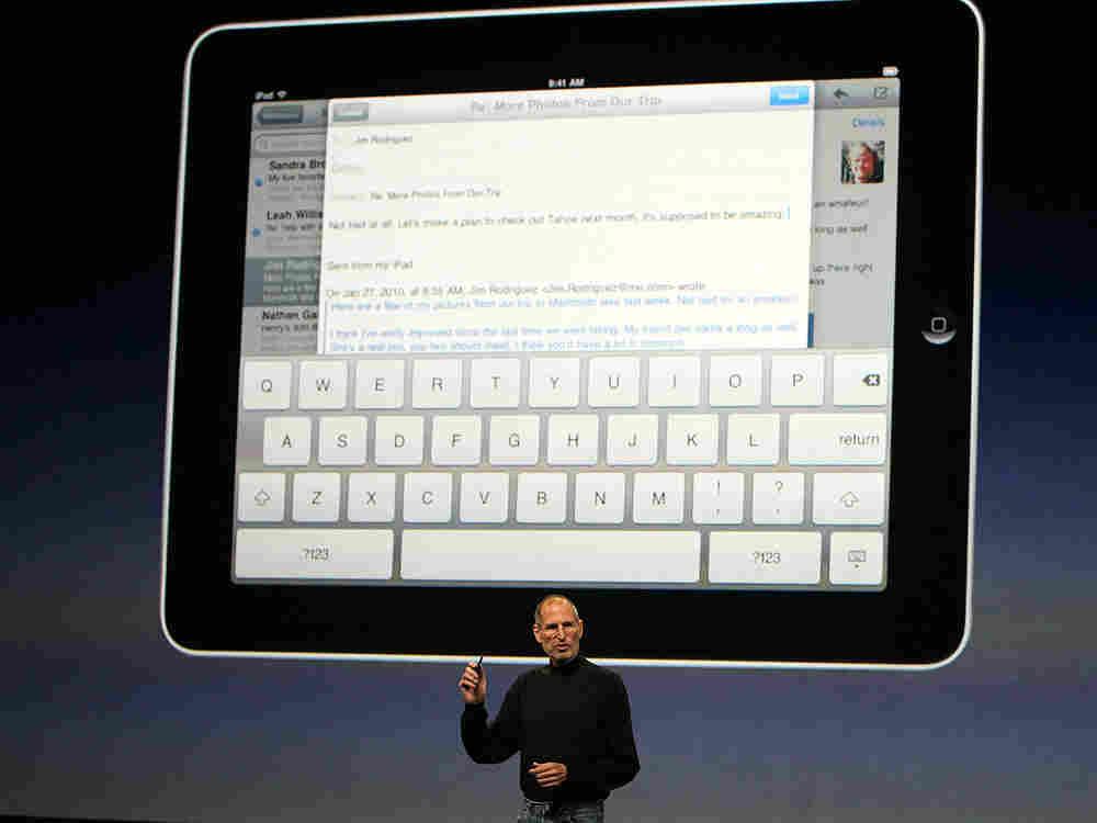Apple CEO Steve Jobs demonstrates the new iPad at the Yerba Buena Center for the Arts on January 27,