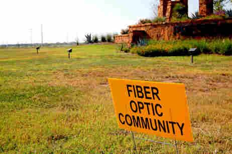 Fiber Optic Community advertised at new suburban development.