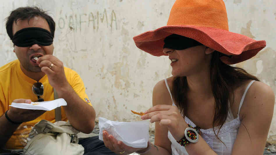 Tourists participate in a blind taste testing.