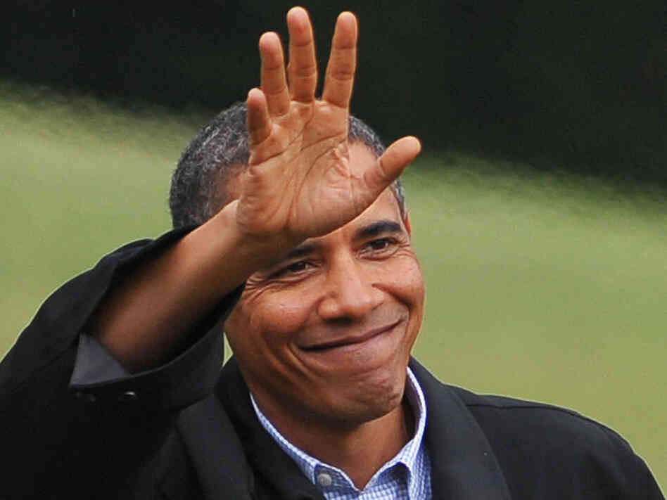 obama waves upon his return from vacation.