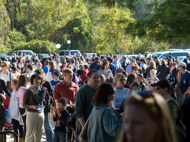 People wait to be vaccinated against swine flu in Rockville, Maryland, on Wednesday.