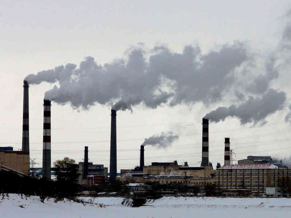 Chinese smokestacks in winter.