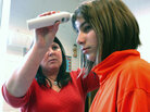 A health aide takes the temperature of a school girl in Wisconsin.
