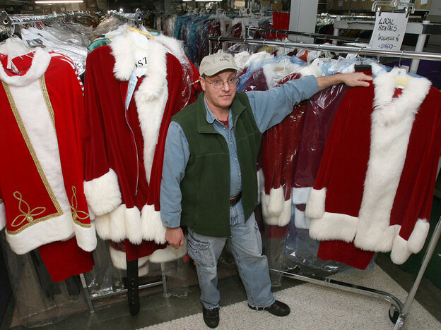 David Oelerich stands by santa suits he rents.