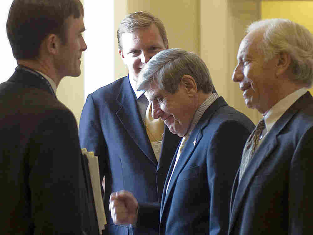 Senator Ben Nelson (D-NE) pumps his fist as he speaks with White House Deputy Chief of Staff Jim Mes