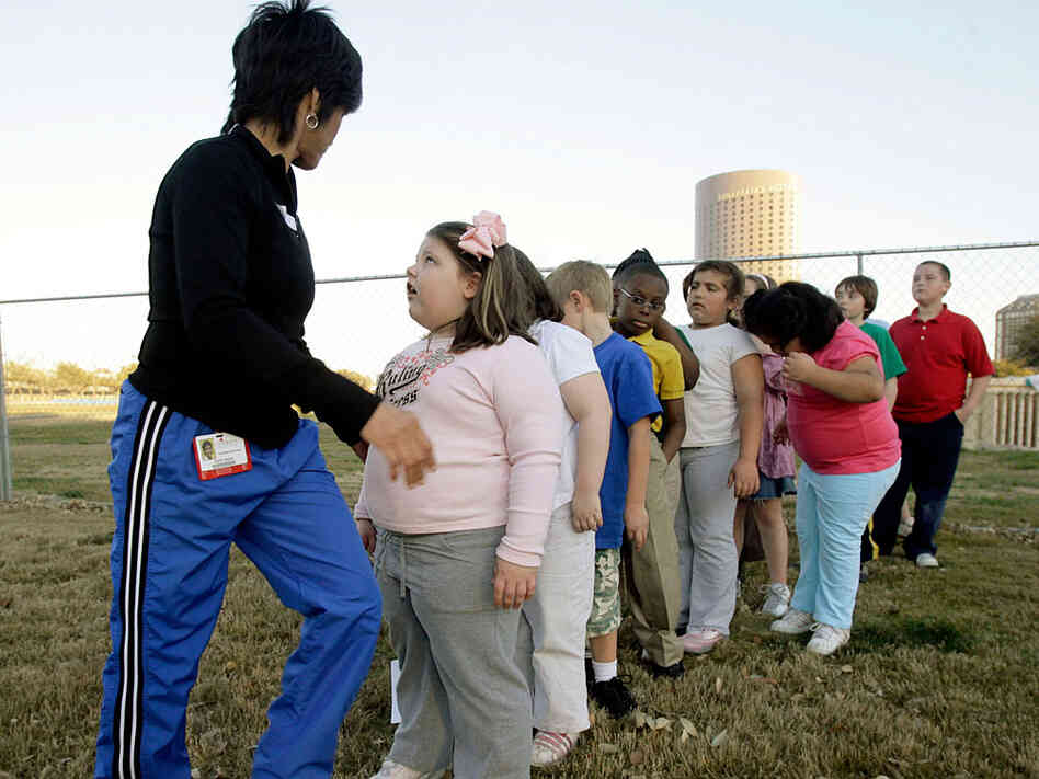 Kids line up for a game of kickball during a program at Children's Medical Center aimed at helping o