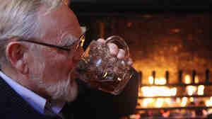 A British man quaffs a cut-price pint last year.