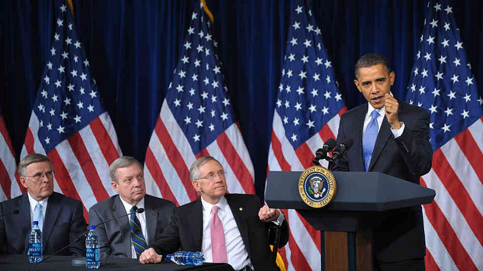 President Obama talks to Democratic senators at a party meeting in Washington, D.C.