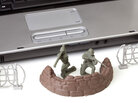 Toy soldiers in front of a laptop.