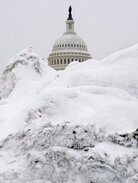 The Capitol dome is seen peeking out through a mound of snow after the Feb. 10 blizzard.