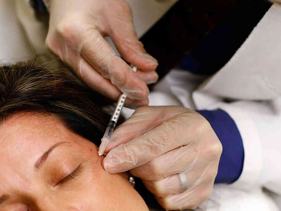 Woman gets free Botox shot.