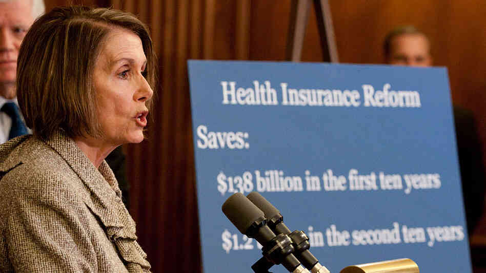 House Speaker Nancy Pelosi reviews health overhaul costs in a Capitol Hill briefing Thursday.