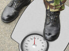 Military boot on scale.