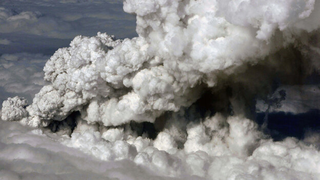 Smoke and steam rises from the volcano under the Eyjafjallajokull glacier in Iceland.