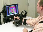 Robot helps stroke patient.