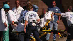 An injured firefighter is brought into the emergency room at St. Vincent's Hospital in Manhattan, Se