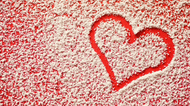 Heart traced in sugar on table.