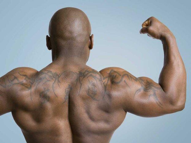 body builder flexes muscle