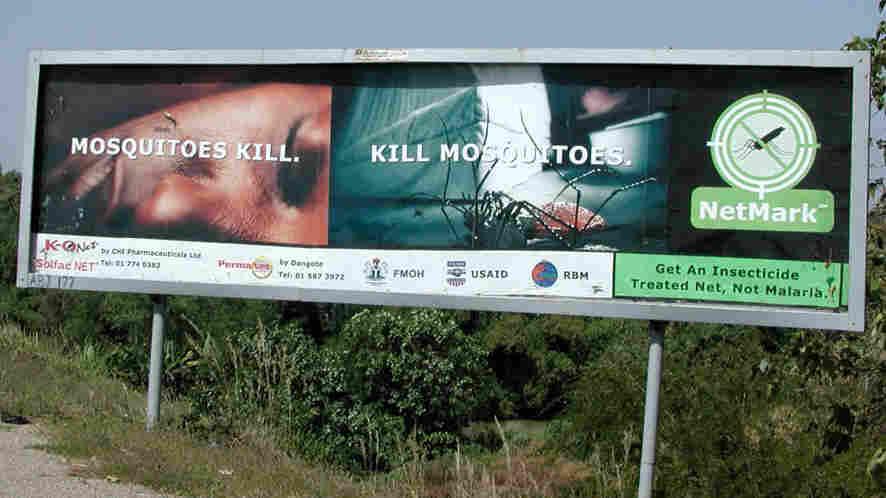 Roadside billboard in Nigeria promotes insecticide-treated nets for malaria prevention.