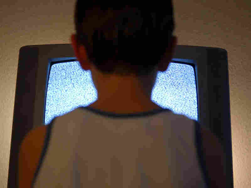 Boy in front of T.V.