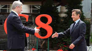 Canadian Prime Minister Harper and French President Sarkozy Meet At G8 Meeting